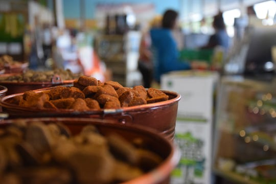 Fresh-baked dog treats sit on a shelf at Naturally 4 Paws in Silverdale. Store owners have opened a second location in Poulsbo.