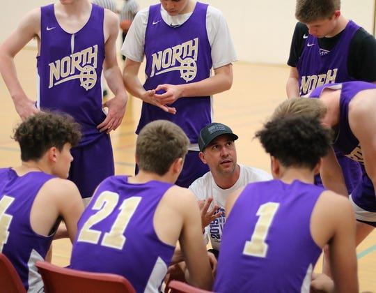 North Kitsap boys basketball coach Scott Orness talks to his team during a Sports Beyond Boys Summer League game June 18 at South Kitsap High School.
