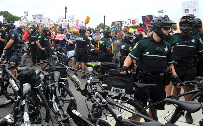 A shouting match ensued near a police barrier at the Amway Center, where President Trump launched his re-election campaign. But no violence occurred.
