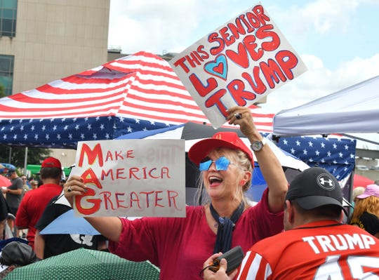 Senior citizen Joy Blessing made these signs in support of the President. Huge crowds turned out for President Trump's official campaign for re-election kickoff at the Amway Center in Orlando, June 18th.