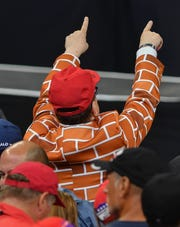A supporter of President Donald Trump wears a suit resembling a brick wall during Trump's June 18 rally at Amway Center in Orlando. Trump officially announced his reelection bid during the event.