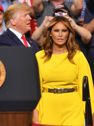 President Donald Trump and first lady Melania Trump on stage during a rally Tuesday at the Amway Center in Orlando.