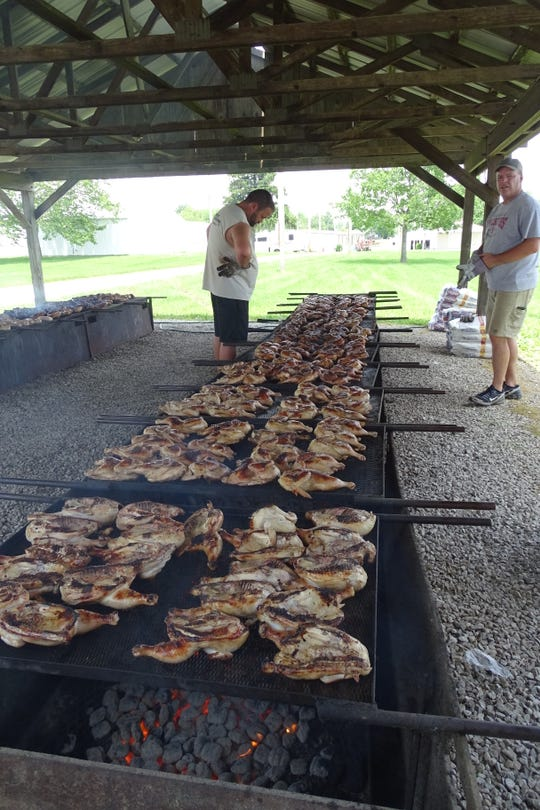 Dane Kennedy and Steve Ritzhaupt keep a close eye on cooking chicken during the annual Bucyrus Kiwanis Club Chicken Barbecue on Wednesday at the Crawford County Fairgrounds.