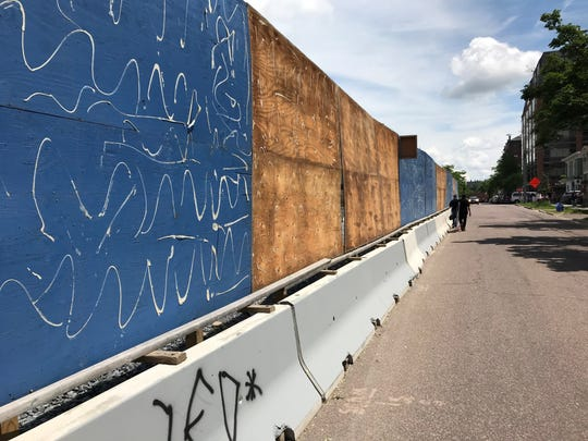 The barrier surrounding the CityPlace construction site, stripped of billboards on Wednesday, June 19, 2019.