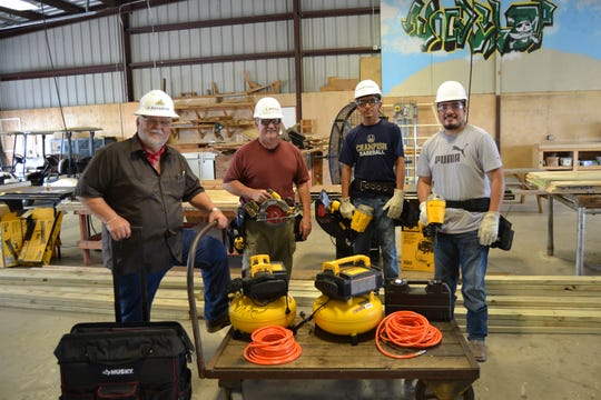 The first class of the Rebuild Texas Carpentry Skills Training program at Rockport-Fulton High School includes (from left) instructor Alex Bayarena and students Terry Roller, Aaron Rodriguez and Fernando Reyes.