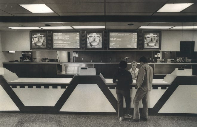 A Whataburger employee takes orders inside a Corpus Christi location in April 1977. Prices at the time were 85 cents for a Whataburger, 99 cents for a Whataburger with cheese, 35 cents for a small fries and 40 cents for a small shake.