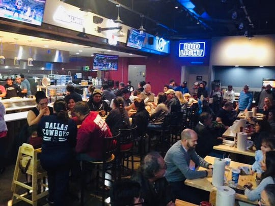 Customers eat at the Bluffalo Wings Co. in Flour Bluff. The second, larger location is planned to open by early fall at 5802 Yorktown Blvd. It will have an outdoor patio and live music.