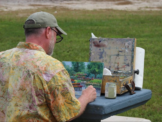 Chuck Law, paints en plein-air (outdoors) in Hammonton, painting 'Flowers for Sale,' 2019, oil on panel.