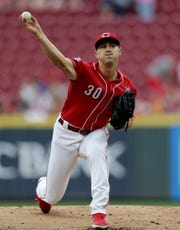Cincinnati Reds starting pitcher Tyler Mahle (30) delivers a pitch in the first inning of the MLB interleague game between the Cincinnati Reds and the Houston Astros at Great American Ball Park in downtown Cincinnati on Wednesday, June 19, 2019. The Reds led 1-0 after two innings.