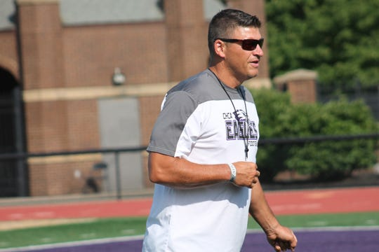 CHCA coach Mark Mueller gets ready for an evening of practice with the Eagles on July 26.