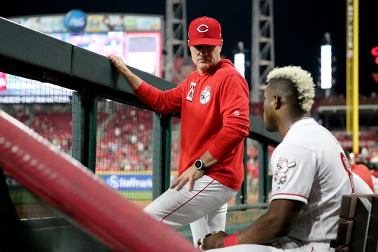 Cincinnati Reds manager David Bell (25) talks with \c68#2\ in the dugout during the seventh inning of the MLB interleague game between the Cincinnati Reds and the Houston Astros at Great American Ball Park in downtown Cincinnati on Tuesday, June 18, 2019. The Reds won 4-3.