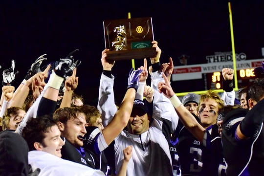 Coach Eric Taylor and the CHCA Eagles hoist the Regional Championship trophy in 2014.
