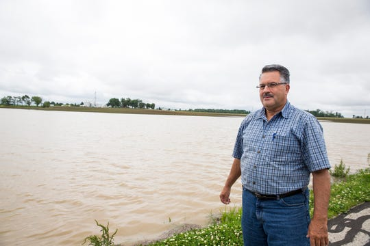 Scott Labig stands in front of a field Monday June 17, 2019 that should be planted with corn. An additional three inches of rain over the weekend made this area of his Darke County land look more like a lake than a farm.