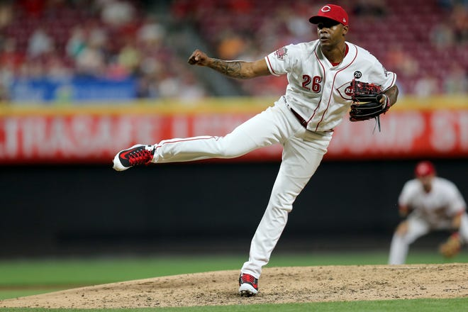 Cincinnati Reds relief pitcher Raisel Iglesias (26) follows through on a pitch in the eighth inning of the MLB interleague game between the Cincinnati Reds and the Houston Astros at Great American Ball Park in downtown Cincinnati on Tuesday, June 18, 2019. The Reds won 4-3.