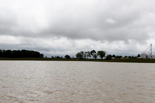 This field is normally planted with corn pictured Monday, June 17, 2019, an additional three inches of rain over the weekend made this area of Scott Labig's Darke County land look more like a lake than a farm.