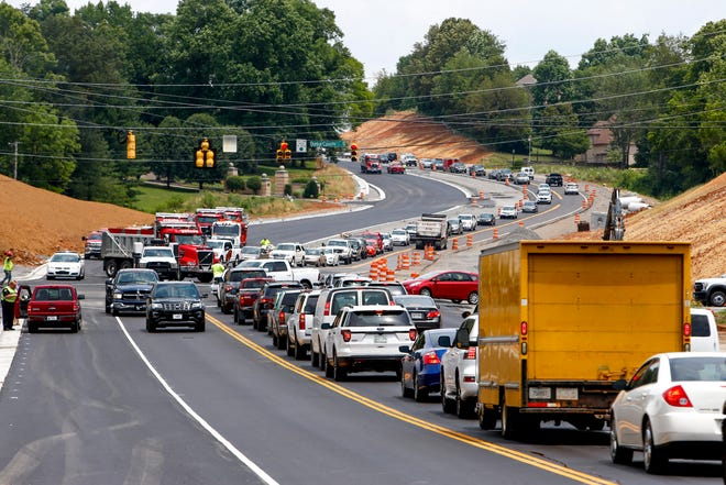 Lines of traffic begin to stack up in both directions on Warfield Boulevard at the intersection of Warfield and Dunbar Cave Road in Clarksville, Tenn., on June 19, 2019.