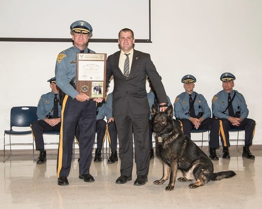New Jersey State Police Colonel Patrick Callahan and Hunterdon County Prosecutor's Office Detective Edward Pawlick and K-9 Mac celebrate the pairs graduation on June 15 from New Jersey State Police K-9 Patrol School.
