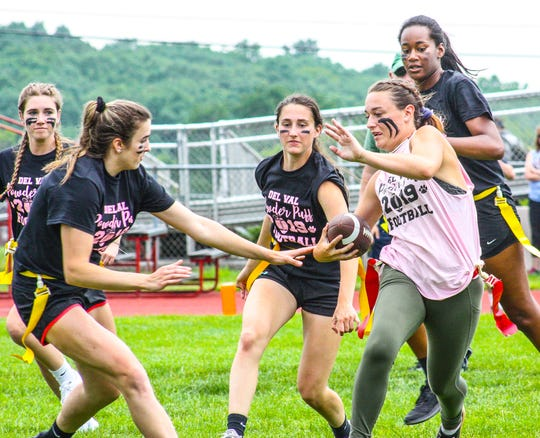Javelin thrower Kimmie Riker scored a touchdown for the Pink Team, in the Powderpuff Football Game. Boys from the varsity football team coached the girls.