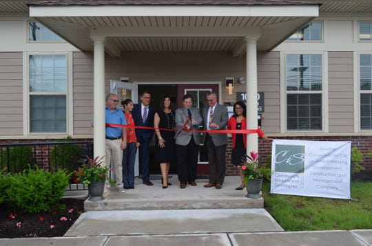 A ribbon-cutting ceremony marked the opening Tuesday of North Brunswick Crescent Apartments, which provides 184 apartments affordable to working families. North Brunswick Mayor Francis M. Womack III, center, cuts the ribbon joined by Christiana Foglio, CEO of CIS, next to the mayor, and other officials during the event.