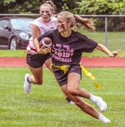 The Powderpuff Football Game is a tradition at Delaware Valley High School's Senior Field Day, which was held Wednesday, June 5. Lacrosse star Kelsey O'Connor scored two touchdowns for the Black Team, which beat Pink 14-6.