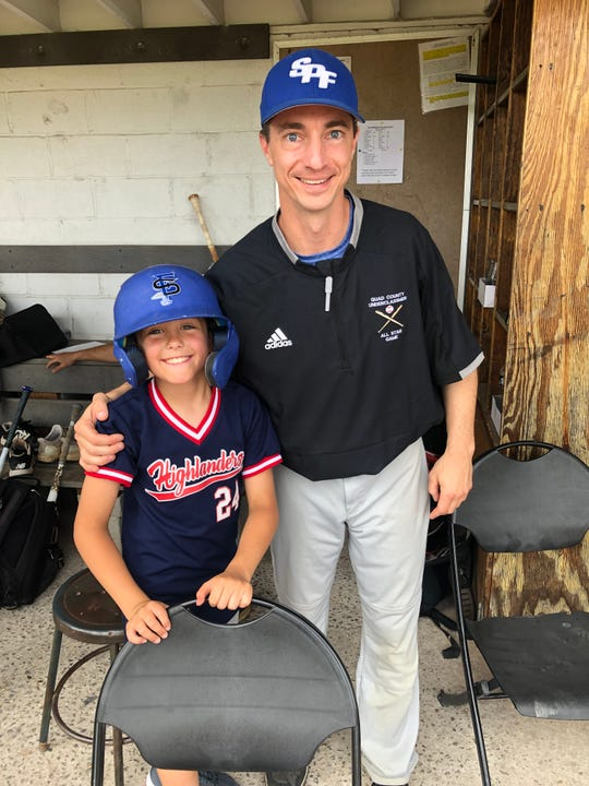 Joe Higgins with Ryan Roof, son of Governor Livingston head coach Chris Roof