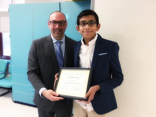 (Left to right) Dr. Jonathan Hart, superintendent and Christopher Serrao Readington Middle School 7th-grade student and National Spelling Bee Champion.