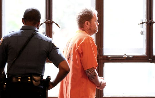 Thomas Wilkie, 46, of Bear, Delaware, leaves the courtroom after a detention hearing at the State Superior Courthouse in Elizabeth, NJ, Wednesday, June 19, 2019. He allegedly brought a loaded gun and more than 130 rounds of ammunition to a Westfield elementary school on June 13.