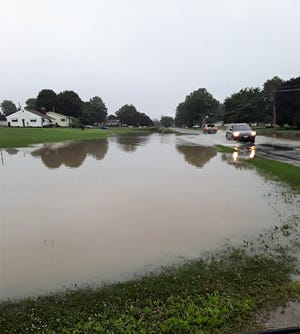 Flash flooding in and around West Lafayette overnight Wednesday led to closure of roads and evacuation of homes.