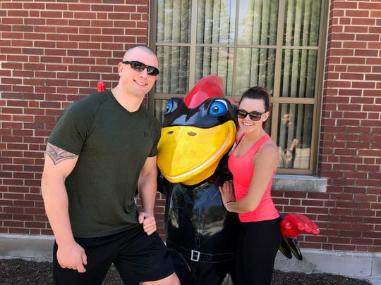 Ames police officer Cory Morrissey and his wife, Richelle, pose alongside Cy the Cop
