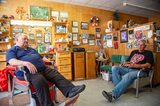Tom Teeple and Chuck Krusey talk about Ed Thomas at Tom's Barber Shop in downtown Parkersburg, Iowa, on Thursday, June 13, 2019.