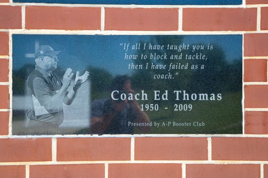 A stone engraving on the wall at Aplington-Parkersburg High School's Ed Thomas Field features a quotation from the coach, who was killed on June 24, 2009.