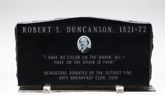One side of the headstone for the grave site of painter Robert S. Duncanson. The headstone was donated by the Detroit Fine Arts Breakfast Club.