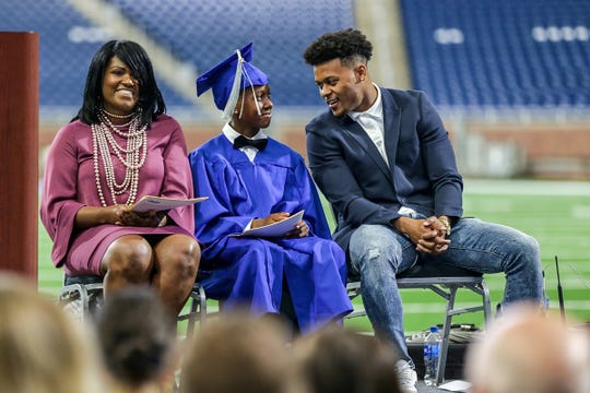 Detroit Lions Jamal Agnew converses with Graduate Elijah Hills, while his principal Alean King looks on from stage, during the Detroit Lions Academy 8th grade graduation held at Ford Field in Detroit on Wednesday, June 19, 2019.