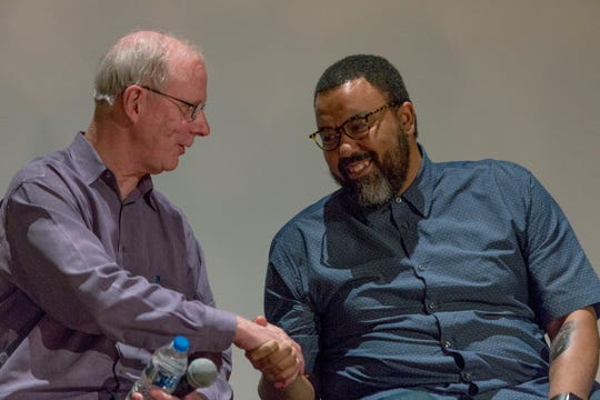 "Bill McGraw, left, and Rashaun Rucker during a panel discussion following the screening of ""12th and Clairmount,"" for the Freep Film Festival at the Detroit Institute of Arts in 2017 in Detroit."