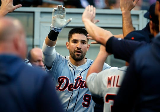 Nicholas Castellanos #9 of the Detroit Tigers celebrates after scoring on a RBI single in the third inning against the Pittsburgh Pirates during inter-league play at PNC Park on June 18, 2019 in Pittsburgh, Pennsylvania.
