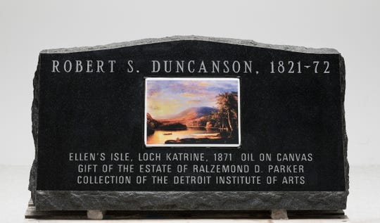 "This side of the headstone for the grave site of painter Robert S. Duncanson features a reproduction of ""Ellen's Isle, Loch Katrine"" (1871) from the Detroit Institute of Arts collection."