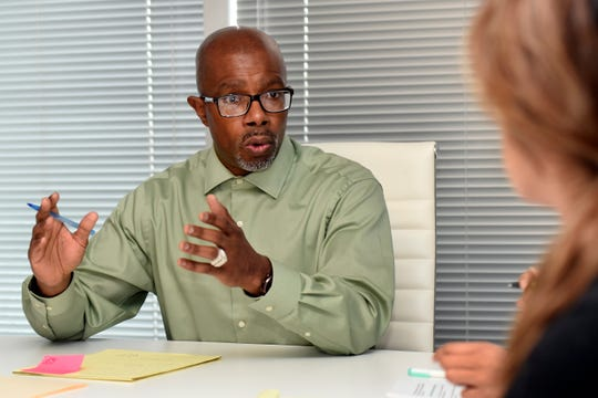 Access Plus founder Darrell Siggers talks with his team, Wednesday, June 19, 2019, in Southfield.