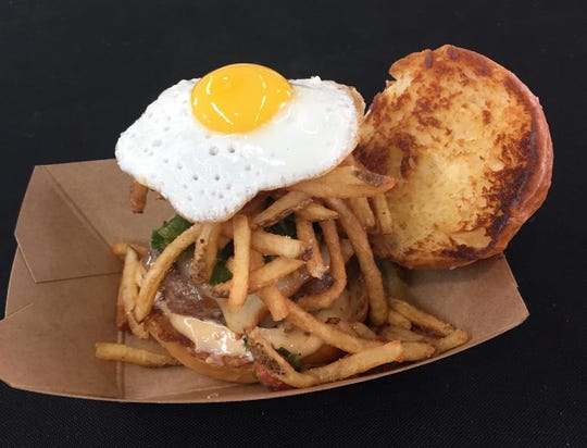 A burger from Frita Batidos restaurant, which won the Burger Battle at Eastern Market in 2017 and 2018.