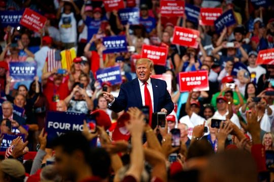 President Donald Trump reacts to the crowd after speaking at his re-election kickoff rally at the Amway Center, Tuesday, June 18, 2019, in Orlando, Fla.