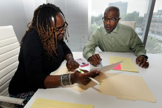 Access Plus Vice President Louise Ingram, left, and founder Darrell Siggers work on strategy for a case.
