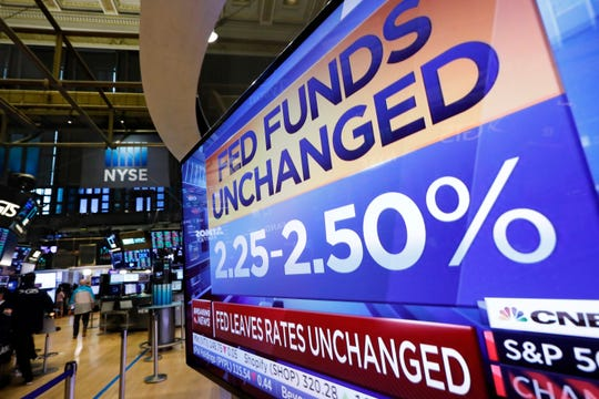 A television screen on the trading floor of the New York Stock Exchange shows the rate decision of the Federal Reserve, Wednesday, June 19, 2019.