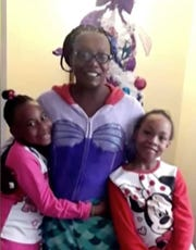 An undated photo of Ineza McClinton and her twin daughters Faith and Angel via Facebook.