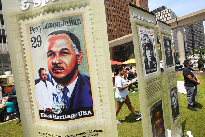 Banners representing pillars of Black Heritage including chemist Percy Lavon Julian line the green space at Spirit Plaza in Detroit during a  Juneteenth celebration Wednesday.