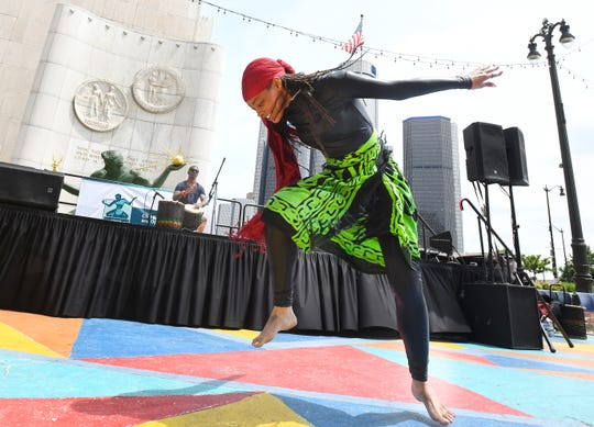Britnee Carter does a West African dance accompanied by African percussionist Sowande Keita during the Juneteeth celebration in Spirit Plaza.
