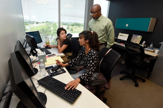 Access Plus founder Darrell Siggers answers questions from Clara Rosales, left, and Tasneia Ahmed, who are both majoring in criminal justice at Wayne State University and interning at Access Plus.