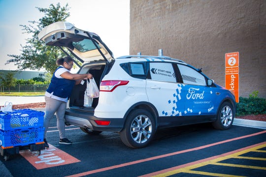 The Ford delivery vans are outfitted with self-driving technology developed by Gatik.