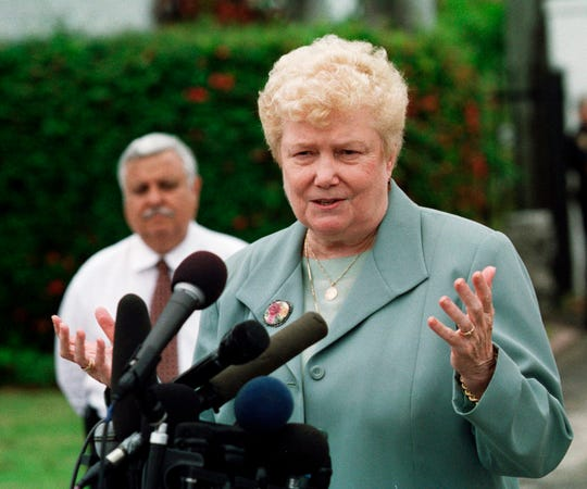 In this April 12, 2000 file photo, Sister Jeanne O'Laughlin, talks with the media after the arrival of Elian Gonzalez and members of his family at her Miami Beach, Fla.