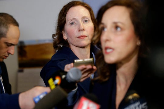In this Tuesday, April 9, 2019 photo Berkshire Eagle reporter Heather Bellow, center left, attends a news conference with Berkshire County District Attorney Andrea Harrington, right, in Pittsfield, Mass. Bellow was recruited as an investigative reporter two years ago as part of a hiring flurry that brought dozens of new jobs to The Berkshire Eagle and its three sister Vermont papers.