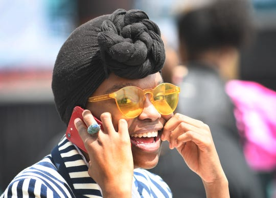 Ayana Love, 24, enjoys the activity at the Juneteenth celebration in Spirit Plaza Wednesday.