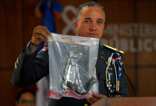 The director of the National Police, General Ney Aldrin Bautista Almonte shows the weapon that was used to shoot former Boston Red Sox slugger David Ortiz, during a news conference at the Attorney General's Office in Santo Domingo, Dominican Republic, last week. Six suspects, including the alleged gunman, have been detained in the shooting, the Dominican Republic's chief prosecutor said.
